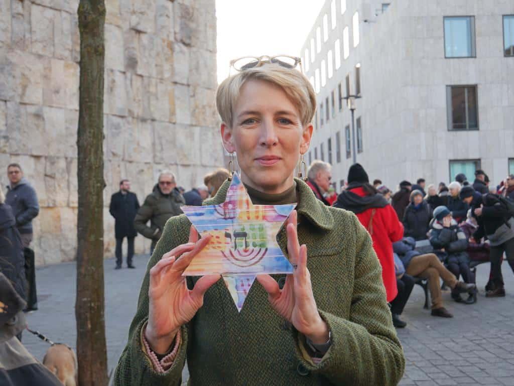 Katrin Habenschaden standing with a J.E.W.S. Star